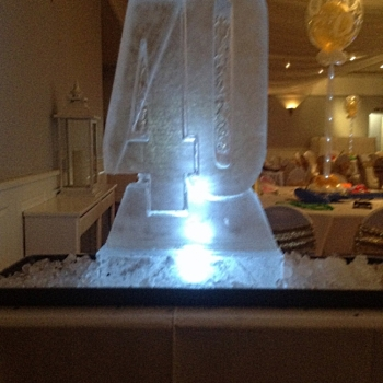 Side angle view of 40 - shaped Vodka Luge from Passion for Ice